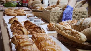 A baker exposing their bakery products on a table