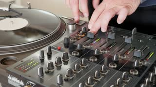 A DJ changes the vinyl and starts to mix music...
