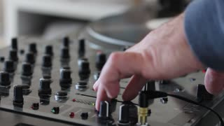 A DJ practicing mixing music at home...