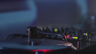 A female DJ scratching on her turntables...