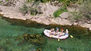 A group of rafters rafting on a river