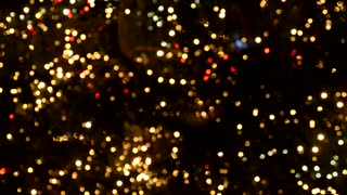 A moving out of focus shot of flickering circle bokeh lights...