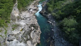 Aerial footage of a rafting route at a river with a rapid on it...