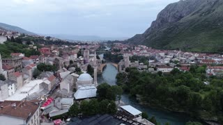 Aerial footage of Mostar, the shot is approaching the old bridge...