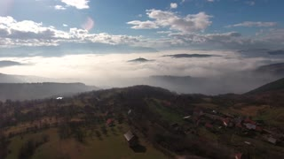 Aerial footage showing a city covered in fog...