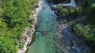 Aerial view of a group of people rafting at a river...