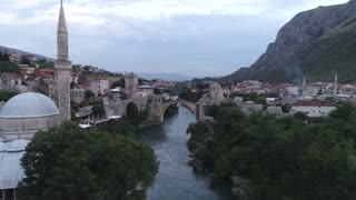 An aerial footage showing Mostar and it´s old bridge, the shot is moving towards the old bridge