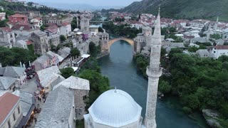 An aerial moving shot showing Mostar and it´s old bridge...