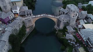 An aerial moving shot showing Mostar´s old bridge...