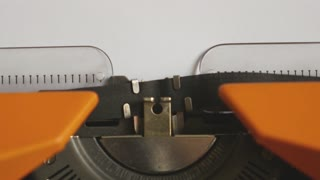 Close up footage of a person writing AUTISMUS on an old typewriter, with sound
