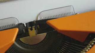 Close up footage of a person writing DIABETES on an old typewriter