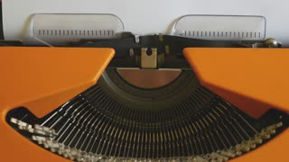 Close up footage of a person writing SUCCESS on an old typewriter, with sound...