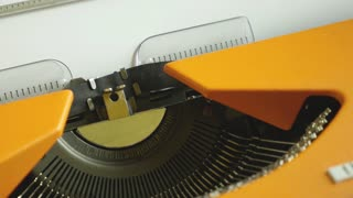 Close up footage of a person writing THE END on an old typewriter...