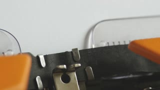 Close up footage of a person writing TOP SECRET on an old typewriter, with sound