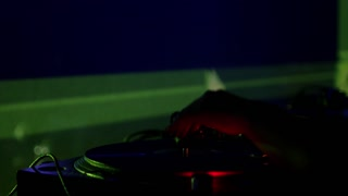 DJ mixing music in a club...