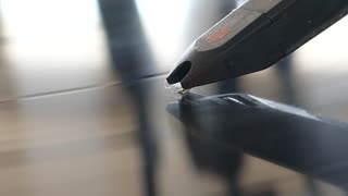 Extreme close up footage of a spherical needle on a rotating vinyl...