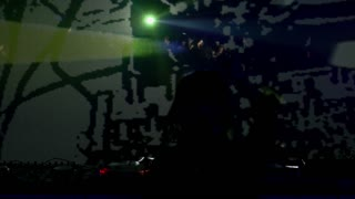 Footage of a female DJ mixing music in a club with a light show in front of her and the crowd enjoying in the music...