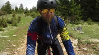 Footage of a mountain biker cycling downhill...