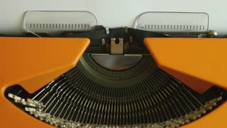 High angle footage of a person writing FINANCIAL CRISIS on an old typewriter, with sound