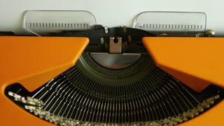 High angle footage of a person writing FINANCIAL CRISIS on an old typewriter, with sound...