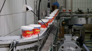 Sarajevo, Bosnia and Herzegovina, 13th September, 2017 - Footage of sour cream plastic bins going to the packing process at a milk and cheese company...