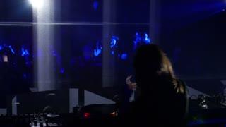 Sarajevo, Bosnia and Herzegovina - February 3rd, 2017- A female DJ mixing music on her audio mixer in a disco...