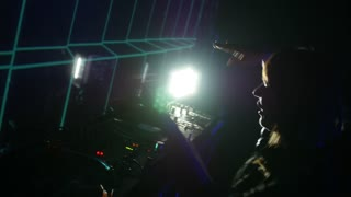 Sarajevo, Bosnia and Herzegovina - February 3rd, 2017- A female DJ mixing music on her audio mixer in a club