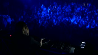 Sarajevo, Bosnia and Herzegovina - February 3rd, 2017- A female DJ mixing music on her audio mixer in front of the crowd in a club...