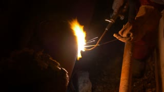 Welding together a ruptured heating system pipe...