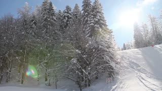 Winter scene, a ski slope at a mountain - the shot moves from left to right