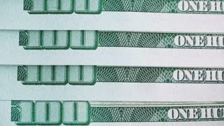 100 dollar bill close up sliding shot