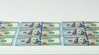 100 Dollar Bills Marching Forward