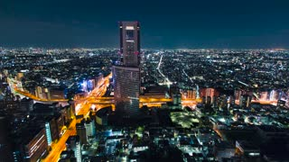 Aerial timelapse of a massive intersection at night in Tokyo