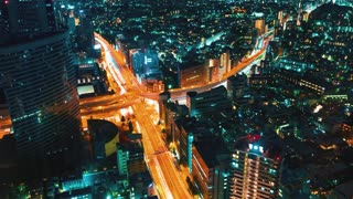 Aerial view time-lapse of a highway intersection in Tokyo