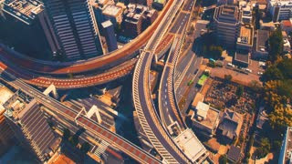 Aerial view time-lapse of a massive highway intersection in Shinjuku, Tokyo, Japan.