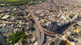 Aerial view time-lapse of a massive highway intersection in Tokyo