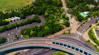 Aerial view time-lapse of traffic and the monorail  line in Odaiba, Tokyo, Japan