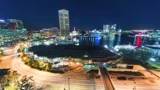 Aerial view timelapse of Baltimore Inner Harbor at night