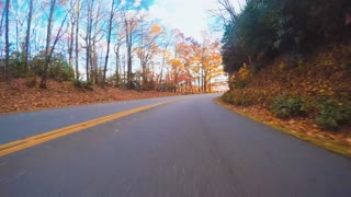Autumn driving shot of the Blue Ridge Parkway at sunset