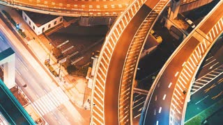 Close-up aerial view time-lapse of a highway intersection in Tokyo