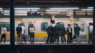 Commuters waiting to board trains at the subway station in Tokyo