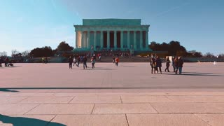 Crowds of people visiting the Lincoln Memorial in Washington DC