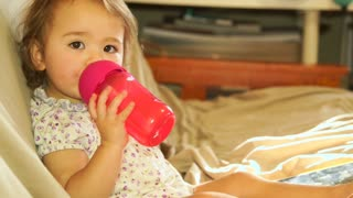 Cute toddler drinking from her bottle
