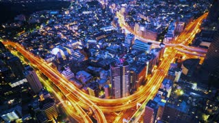 Day turns to night over a massive highway intersection in Tokyo, Japan