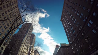 Driving shot looking up at Manhattan buildings
