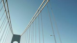 Driving shot looking up at the Verrazano Bridge