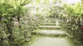 Dynamic shot of the 500 statues of the garden of Daisho-in Temple, Miyajima