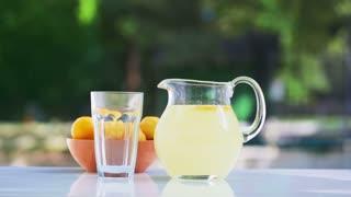 Fresh lemonade pouring into a glass