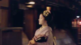 Geisha entering a tea house in Kyoto