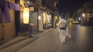 Geisha walking down the street in the Gion district of Kyoto